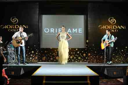 Model walking the ramp alongside the live band performance  at Oriflame's GG relaunch event.JPG