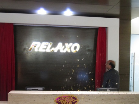 Mr. Rakesh Kumar Dua, MD, Relaxo Footwear Pvt. Ltd. inaugrating the new brand logo of Relaxo.JPG
