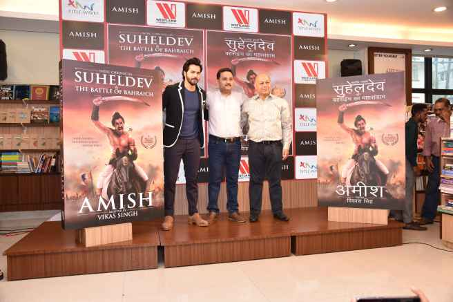 L-R_Varun Dhawan, Amish,Vikas Singh at the cover launch of Suheldev and the Battle Of Bahraich (1) (1)